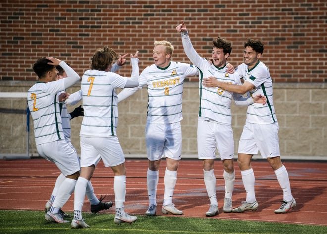 The UVM men's soccer team celebrates a goal in Thursday's 1-0 win over NJIT in the America East semifinals at Durham, New Hampshire.