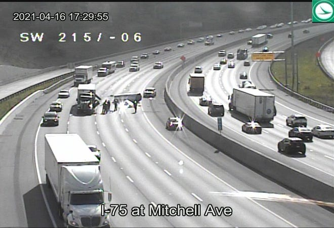 An Ohio Department of Transportation camera shows traffic moving in the far left lane around three closed lanes where police said a metal coil came off a truck.