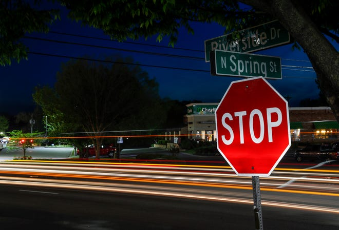 In this long exposure photograph, the lights of cars passing by on Riverside can be seen at the intersection of Riverside Dr. and North Spring St. in Clarksville, Tenn., on Thursday, April 15, 2021. A pedestrian was struck and killed near this intersection in recent months.