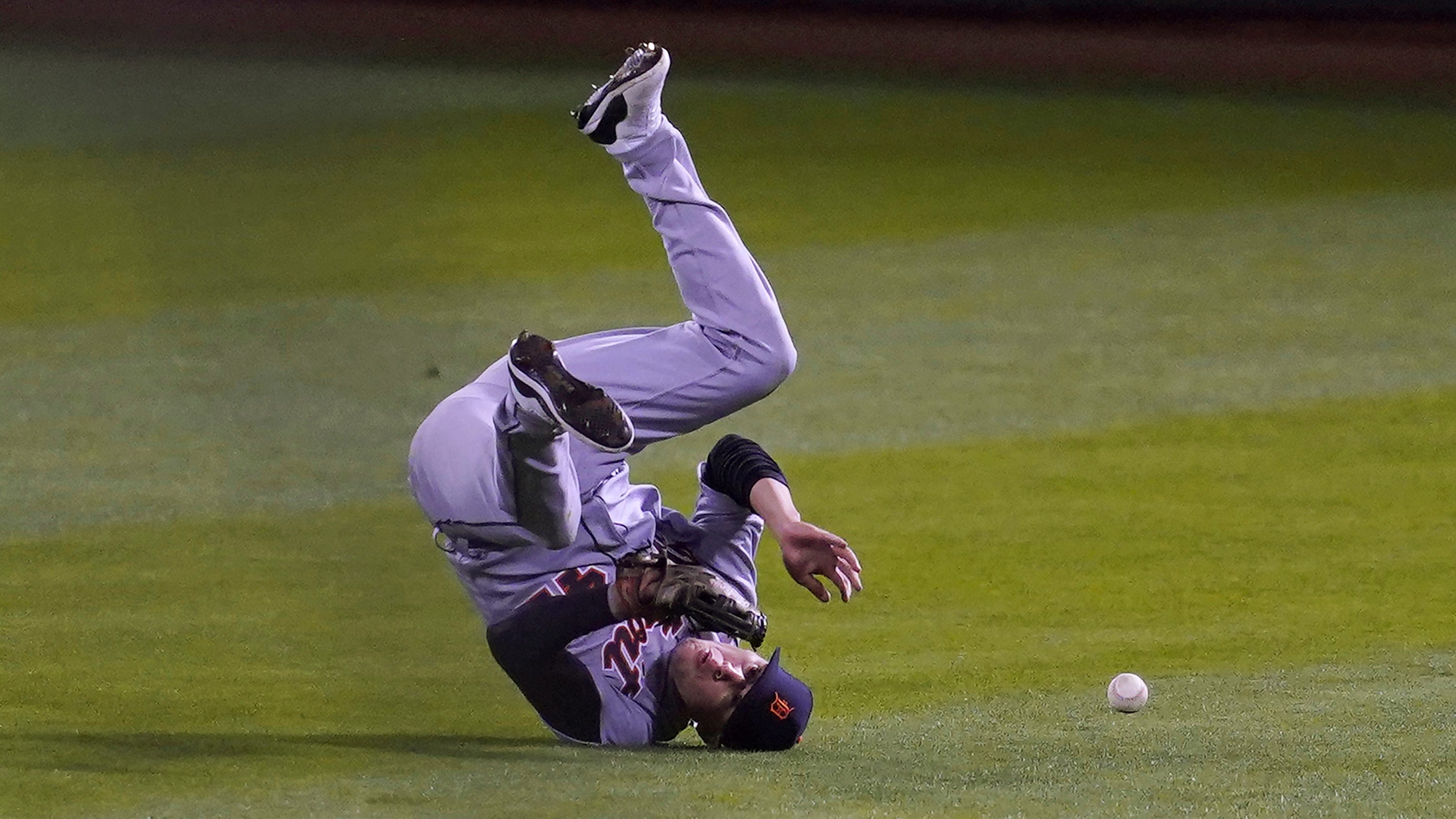 Detroit Tigers center fielder JaCoby Jones cannot catch a base hit by Oakland Athletics' Mark Canha during the seventh inning in Oakland on Thursday, April 15, 2021.