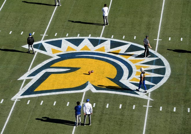 LAS VEGAS, NEVADA - DECEMBER 19:  Placekicker Matt Mercurio #39 of the San Jose State Spartans warms up on the team's logo at midfield before the Mountain West Football Championship against the Boise State Broncos at Sam Boyd Stadium on December 19, 2020 in Las Vegas, Nevada.
