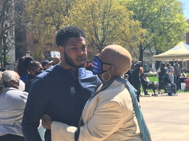 Rep. Jewell Jones, D-Inkster, receives a hug from Rep. Cynthia Johnson, D-Detroit, during a rally at the Michigan Capitol on Tuesday, April 13, 2021.
