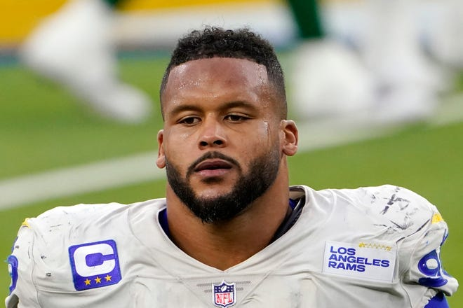FILE - A lawyer and his 26-year-old client told Pittsburgh police Wednesday, April 14, 2021, that Los Angeles Rams defensive lineman Aaron Donald and others assaulted the man at a nightclub last weekend, causing multiple injuries. (AP Photo/Jae C. Hong, File)