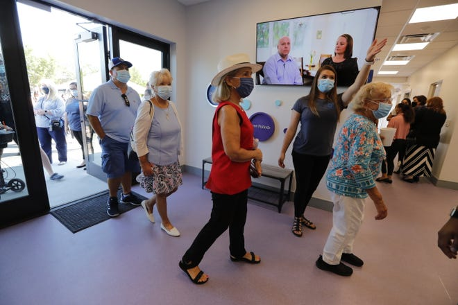 A staff member conducts a tour of the new Autism Support Center in Cape Coral, Thursday, April 8, 2021. Family Initiative Inc. was hosting a ribbon-cutting ceremony for the facility.