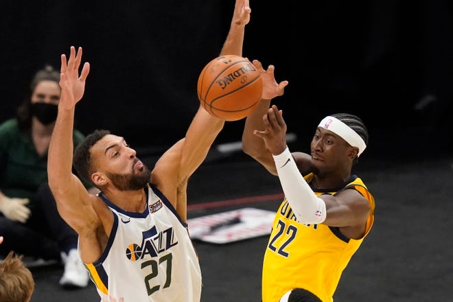 Utah Jazz center Rudy Gobert (27) defends against Indiana Pacers guard Caris LeVert (22) during the first half of an NBA basketball game Friday, April 16, 2021, in Salt Lake City. (AP Photo/Rick Bowmer)