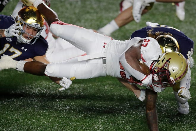 Notre Dame defensive lineman Jordan Botelho (17) tackles Boston College running back Travis Levy (23) during the first half of an NCAA college football game, Saturday, Nov. 14, 2020, in Boston. (AP Photo/Michael Dwyer)