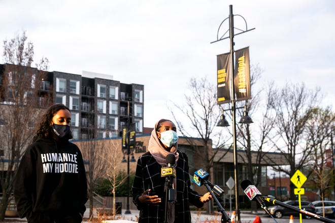 Cofounders of the Iowa Freedom Riders, Ala Mohamed, right, and Raneem Hamad speak to reporters during a news conference before the inaugural Peoples Truth & Reckoning Commission meeting April 15 at Chauncey Swan Park in Iowa City.
