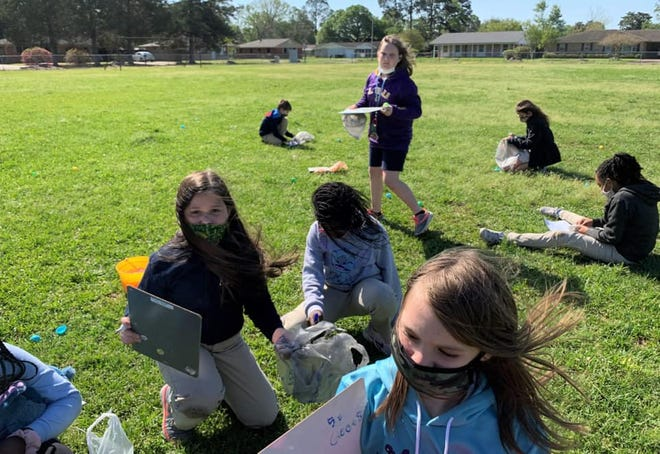 Heba Elseginy, fourth-grade French immersion teacher at Park Vista Elementary School in Opelousas, challenges her students with an Easter egg hunt with a twist. The eggs were filled with math problems for them to solve.