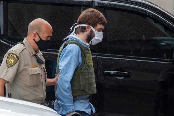 Ian Howard, 31, is accused of committing first-degree murder in the Oct. 1, 2017 shooting death of Lafayette Cpl. Michael Middlebrook is escorted to the Lafayette Parish Courthouse.. Friday, April 16, 2021.