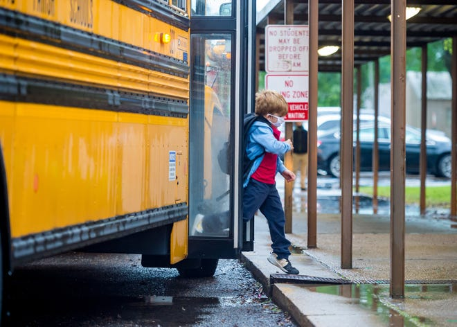 Students arrive at S.J. Montgomery School Friday, April 16, 2021.