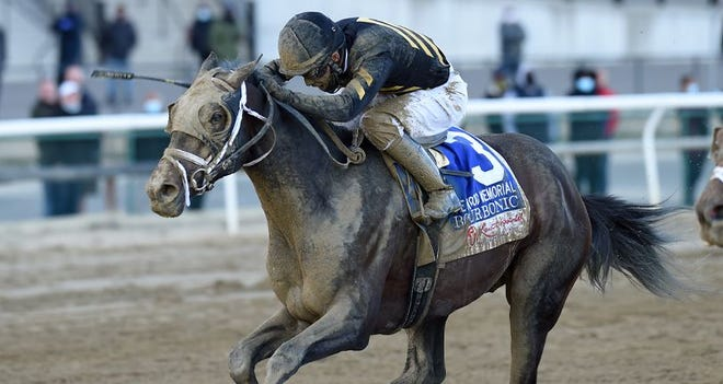 Bourbonic and jockey Kendrick Carmouche win the Wood Memorial on April 3 at Aqueduct. (Photo courtesy of Chelsea Durand/New York Racing Association.)