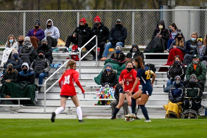 Fans watch the DeWitt vs. Mason girls soccer game during the first half on Thursday, April 15, 2021, at DeWitt High School's soccer field. DeWitt
