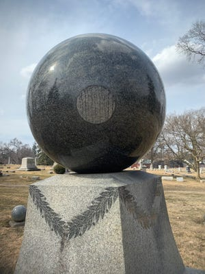 The Merchant Ball is a sculpture at the Marion Cemetery. The ball serves as a grave marker for C. B. Merchant.