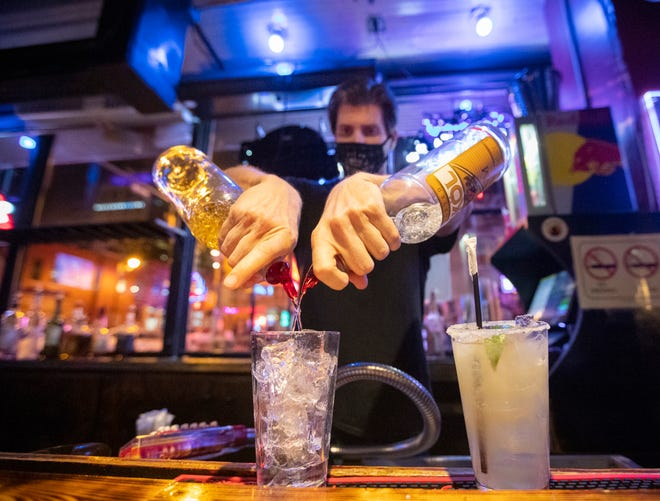 Mike Steadman mixes drinks behind the bar at B.B. King for the crowd taking in live music on Beale Street on Thursday, April 15, 2021.