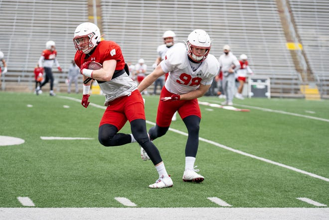 UW tight end Jack Eschenbach, left, takes part in a recent spring practice.