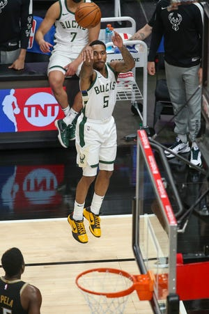Bucks guard Jeff Teague jacks up a three-pointer against the Atlanta Hawks during the fourth quarter in a game in April. Teague, picked up by the Bucks in late March, has spent a majority of his career with the Hawks.