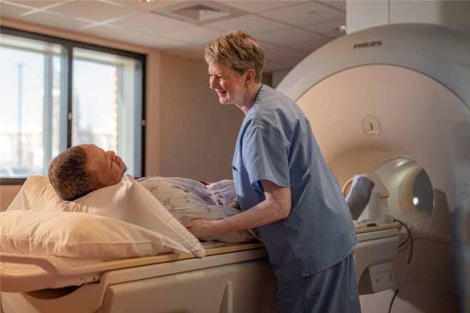 Eileen Huc, an MRI technician, with a patient at the Orthopaedic Hospital of Wisconsin
