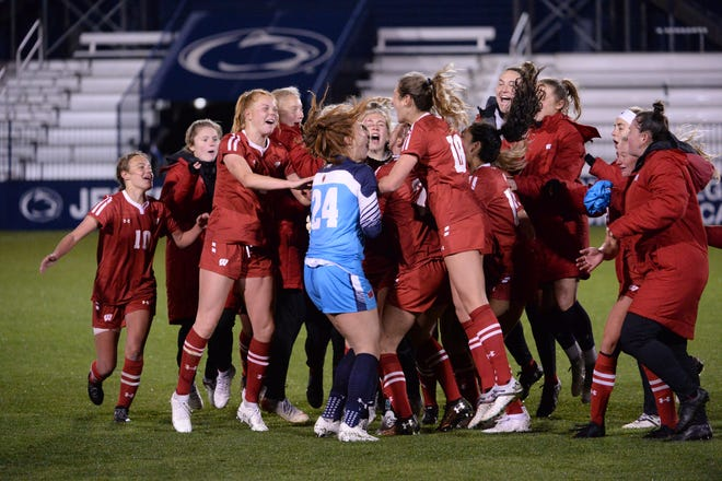 Members of the Wisconsin Badgers women's soccer team celebrate after beating Rutgers on Thursday, April 15, 2-1, in the Big Ten Tournament semifinal.