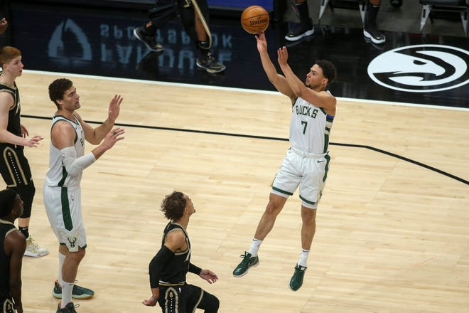 Bucks guard Bryn Forbes goes up for a jumper just outside the lane against the Hawks in the first quarter.