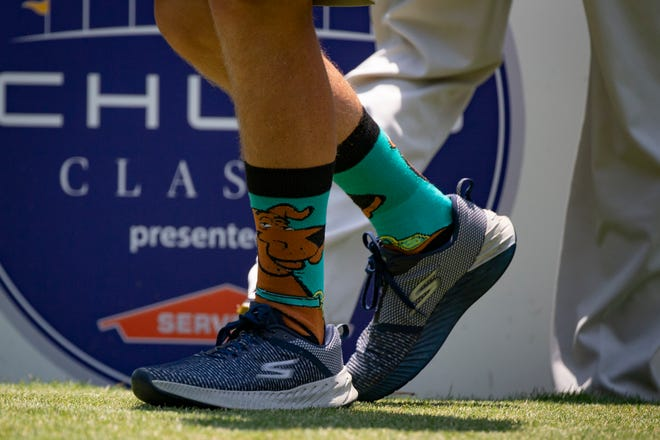 Keith Nolan, caddie for golfer Scott Parel, wears Scooby-doo socks during the first day of the Chubb Classic, Friday, April 16, 2021, at the Tiburon Golf Club in North Naples. Nolan and Parel wore the special socks in memory of Chubb Classic volunteer  Brendan Cunningham, for who was known for wearing eccentric socks.