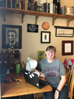 Licking Heights High School instructor Gina Daniels recently completed her 1000th face covering to help fight COVID spread.