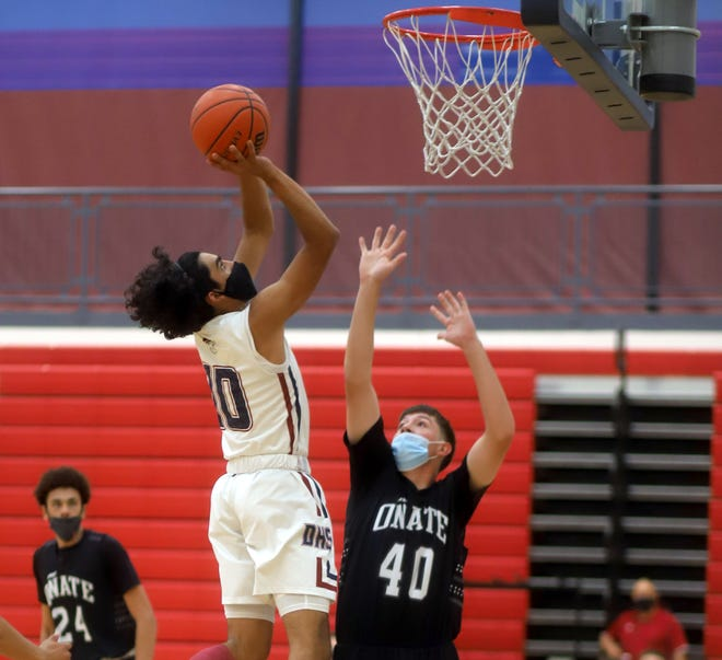 Sophomore Wildcat Alex Alfaro (10) had his way with the Onate Knights' defense on his way to a game-high 29 points in a 77-66 loss on Thursday at Deming High School.