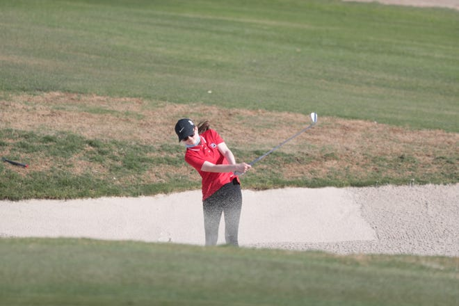 Lily Poulmau of Palm Desert High School blasts out of a bunker onf the third hole at Classic Club in Palm Desert Thursday.