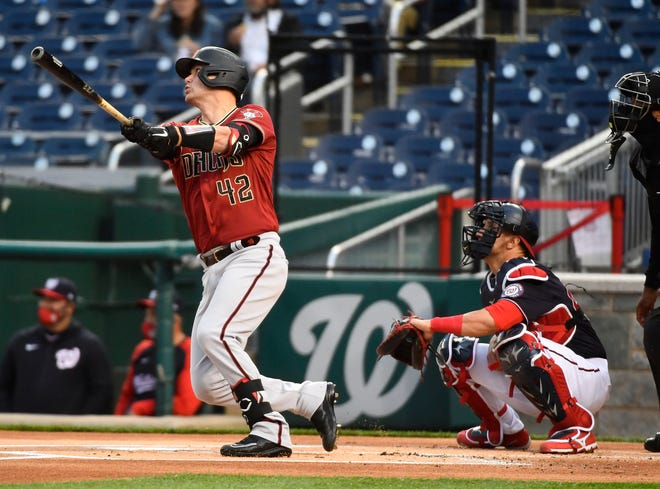Apr 15, 2021; Washington, District of Columbia, USA; Arizona Diamondbacks catcher Carson Kelly (18) hits a solo home run against the Washington Nationals during the first inning at Nationals Park. Mandatory Credit: Brad Mills-USA TODAY Sports