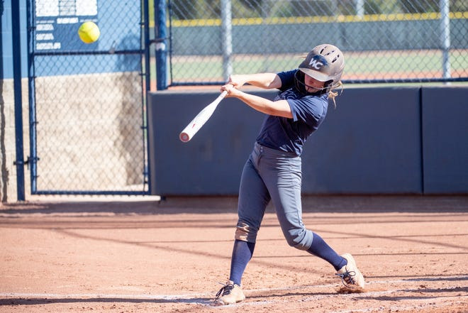 Willow Canyon softball player Alannah Rogers gets a hit at the plate during a game.