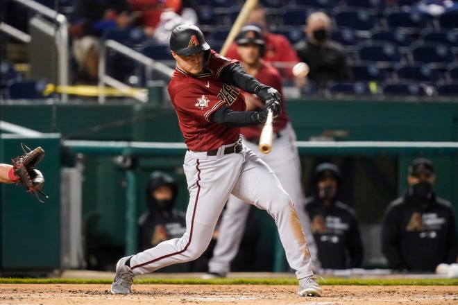 Arizona Diamondbacks' Andrew Young hits a grand slam during the second inning of the team's baseball game against the Washington Nationals at Nationals Park, Thursday, April 15, 2021, in Washington. (AP Photo/Alex Brandon)