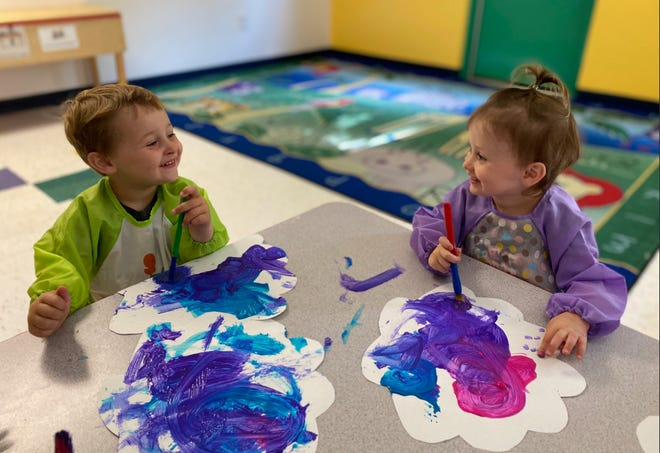 Children at The Learning Experience in Phoenix paint clouds to raise money to grant wishes for sick children while learning lessons their teachers hope will last a lifetime.
