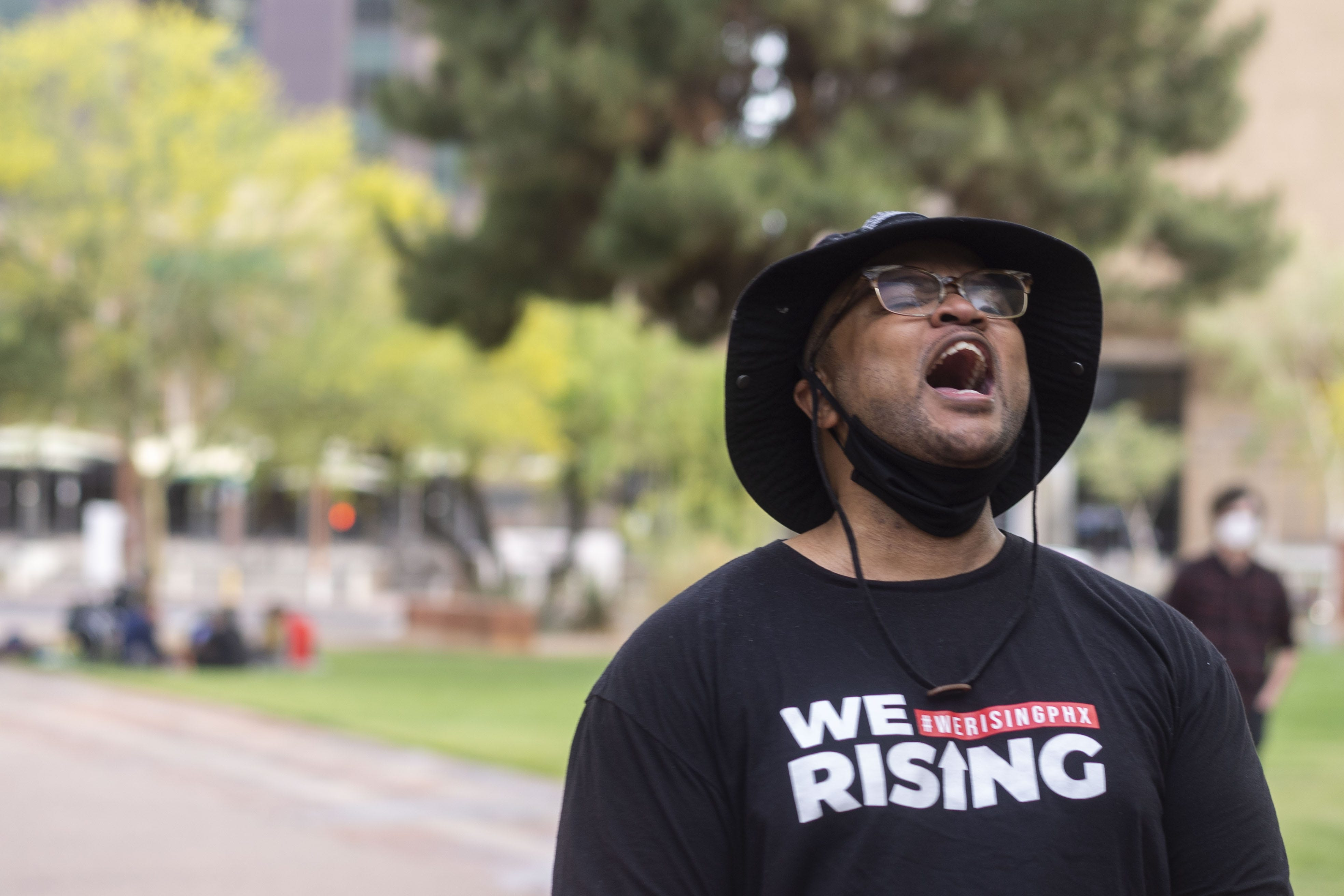 Jacob Raiford speaks to the crowd at the rally against police brutality at Cesar Chavez Plaza at Phoenix City Hall on Washington Street in downtown Phoenix on April 15, 2021.