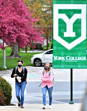 Sophomores Melina Piervencenti, left, and Meghan Stefek walk onto the York College of Pennsylvania campus in Spring Garden Township, Friday, April 16, 2021. Dawn J. Sagert photo
