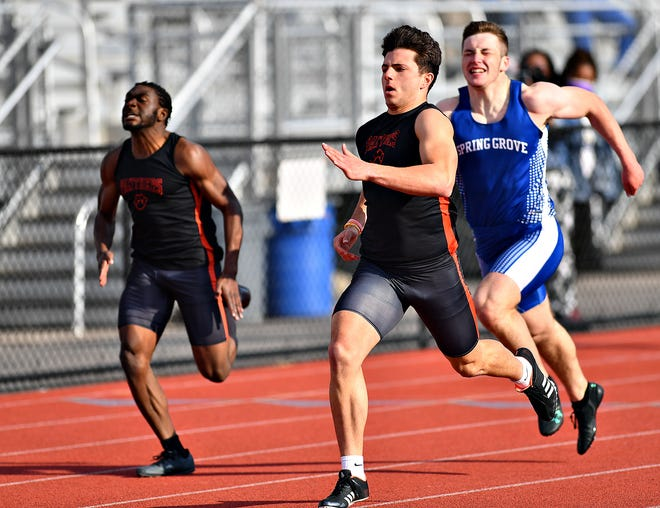 Central York's Parker Hines wins the first heat of the boys' 200-yard dash during track and field action against Spring Grove at Central York Senior High School in Springettsbury Township, Thursday, April 15, 2021. Dawn J. Sagert photo