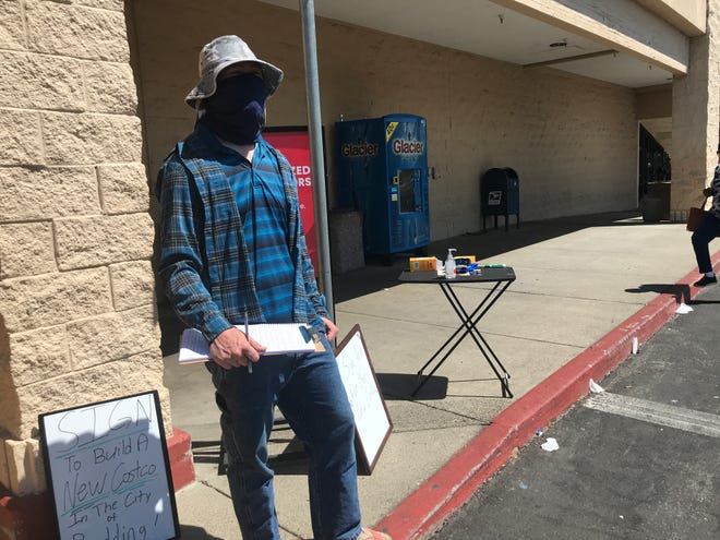 Kyle Lowman worked to collect signatures for a petition to help Costco to finally relocate its store in Redding. He was at Raley's on Friday, April 16, 2021.