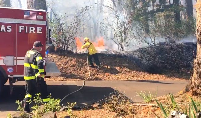 Crews work to contain the brush fire off of Redland and Neibur Rd in Clackamas County on Friday, April 16, 2021.