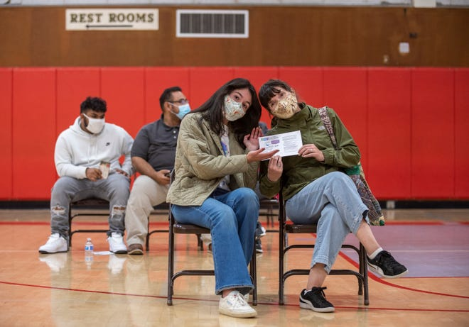 Sophia Lopez, Salinas High School student, 17, is photographed sitting next to her mom Sandra Marques after Lopez received the first dose of the Pfizer vaccine during a mobile vaccine clinic hosted by All-In Monterey and Central Avenue Pharmacy in Salinas Calif., on Thursday, April 15, 2021.