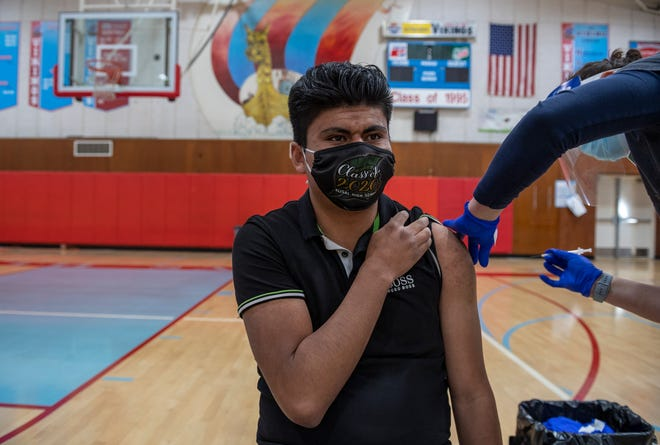 Ismael Rodriguez, Hartnell College student, 19, gets his first dose of the Pfizer COVID-19 vaccine in Salinas Calif., on Thursday, April 15, 2021.