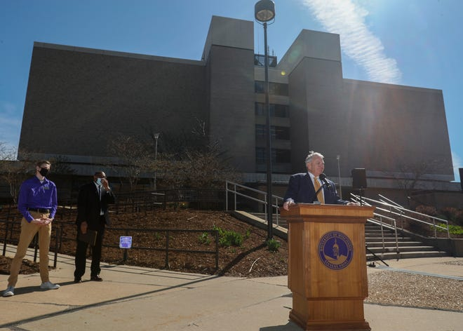 Interim University of Wisconsin System President Tommy Thompson addresses the media outside of Albertson Hall on Friday at the University of Wisconsin-Stevens Point. The university is lobbying for funding to replace the building, which serves as the main campus library.
