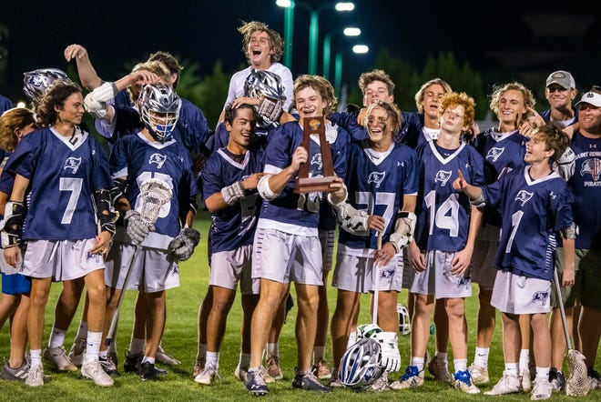 The St. Edward's boys lacrosse team celebrates their win over the Benjamin School in the District 8-1A championship on Thursday, April 15, 2021, at St. EdwardÕs School in Vero Beach. St. EdwardÕs won 17-10.