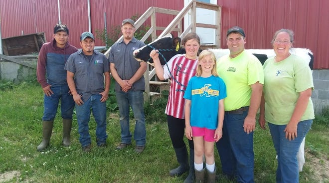 Hilda is owned by Andrew Jay and Lynette E. Buttles of Lancaster, Wisconsin, seen here with family and employees.