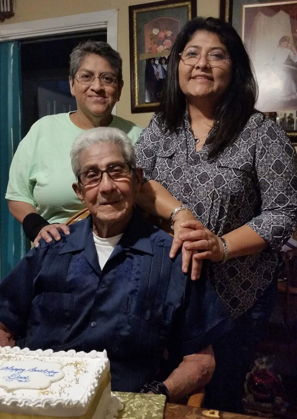 Guadalupe Ramirez, back left, with her partner, Diane Muniz, and her father, Celedonio, received monoclonal antibodies after a positive test for the coronavirus in January.