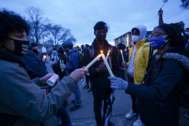 Community members protest after the fatal shooting of Daunte Wright in Brooklyn Center, Minn., on April 15, 2021. Officer Kim Potter, 48, fatally shot Wright during a traffic stop April 11, 2021.