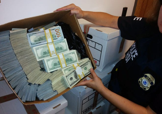 This photo provided by U.S. Immigration and Customs Enforcement shows a box of cash that was among items seized by federal agents in Los Angeles on Sept. 10, 2014. Federal prosecutors said they arrested nine people and seized $65 million in a sweep aimed at alleged money laundering operations.