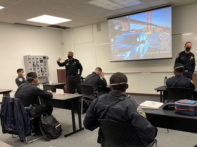 "Lt. Michael Nevin (gesturing at left) is shown here in a training session for San Francisco Police Department officers. ""No-news incidents are the great-news incidents,"
