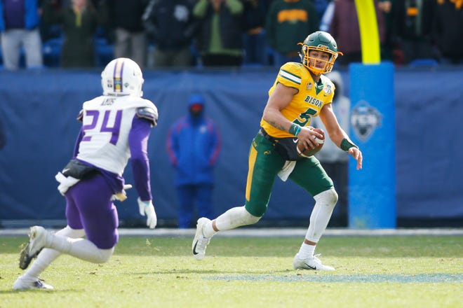 North Dakota State Bison quarterback Trey Lance (5) scrambles from James Madison Dukes safety D'Angelo Amos (24) in the third quarter at Toyota Stadium.