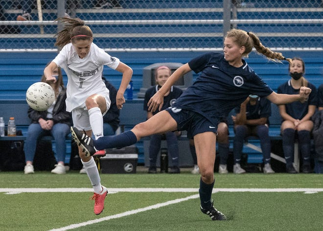 Vandegrift's Cameron Patton, left, tries to get to the ball before Flower Mound's Hannah Augustyn can clear it.