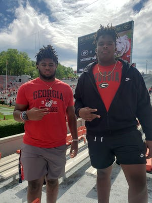 Fellow 2024 recruits Hevin Shuler-Brown and Waltclaire Flynn Jr. pose together following the G-Day game on Saturday.