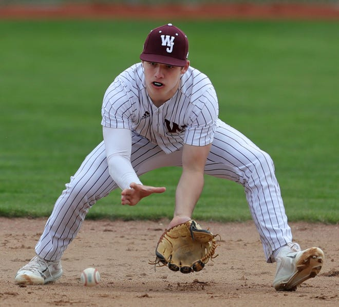 Walsh Jesuit shortstop Henry Kaczmar has helped to lead the Warriors, coached by his father Chris Kaczmar, to a Division I state semifinal. [Jeff Lange/Beacon Journal]