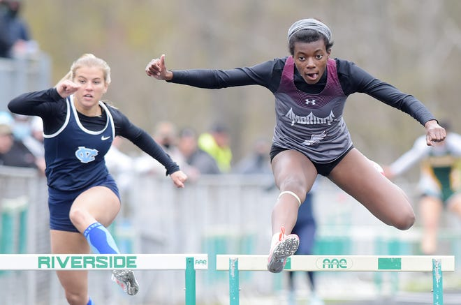 Ambridge's Bethany Naughton clears the last hurdle for first place in the 300-meter hurdles during the Beaver County Track and Field Championships at Riverside High School.